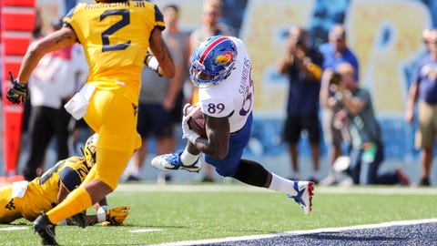 Oct 6, 2018; Morgantown, WV, USA; Kansas Jayhawks tight end Mavin Saunders (89) catches a pass for a touchdown against the West Virginia Mountaineers during the first quarter at Mountaineer Field at Milan Puskar Stadium. Mandatory Credit: Ben Queen-USA TODAY Sports