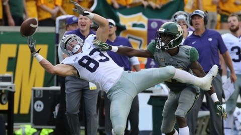Kansas State Dalton Schoen, left, reaches for an incomplete pass over Baylor Kalon Barnes, right, during the first half of an NCAA college football game, Saturday, Oct. 6, 2018, in Waco, Texas. (Rod Aydelotte/Waco Tribune-Herald via AP)