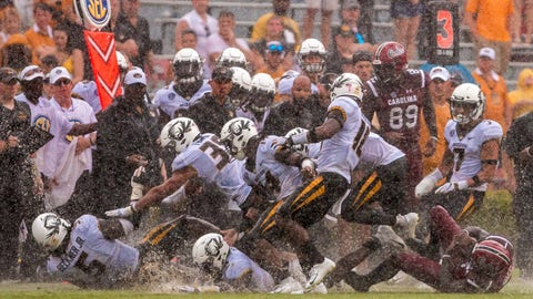 Oct 6, 2018; Columbia, SC, USA; Missouri Tigers and South Carolina Gamecocks players slip in on the wet turf in the second half at Williams-Brice Stadium. Mandatory Credit: Jeff Blake-USA TODAY Sports