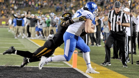 Oct 27, 2018; Columbia, MO, USA; Kentucky Wildcats tight end C.J. Conrad (87) scores the game winning touchdown as Missouri Tigers safety Tyree Gillespie (9) attempts they tackle during the second half at Memorial Stadium/Faurot Field. Kentucky won 15-14. Mandatory Credit: Denny Medley-USA TODAY Sports