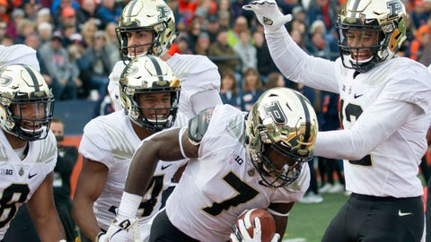Oct 13, 2018; Champaign, IL, USA; Purdue Boilermakers running back Markell Jones (8), wide receiver Rondale Moore (4), quarterback David Blough (11), and wide receiver Jared Sparks (12) celebrate after the touchdown scored by wide receiver Isaac Zico (7) during the second quarter at Memorial Stadium. Mandatory Credit: Mike Granse-USA TODAY Sports