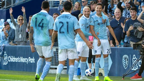 Oct 28, 2018; Kansas City, KS, USA; Sporting Kansas City celebrate with forward Daniel Salloi (20) after he scored a goal during the MLS Western Conference match against the Los Angeles FC at Childrens Mercy Park. Mandatory Credit: William Purnell-USA TODAY Sports