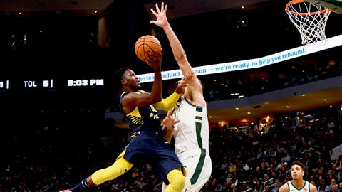 Oct 19, 2018; Milwaukee, WI, USA; Indiana Pacers guard Victor Oladipo (4) drives to the basket against Milwaukee Bucks center Brook Lopez (11) during the second half at Fiserv Forum. Mandatory Credit: Matt Marton-USA TODAY Sports