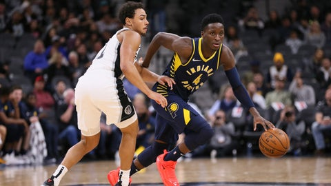 Oct 24, 2018; San Antonio, TX, USA; Indiana Pacers shooting guard Victor Oladipo (4) moves the ball against the defense of San Antonio Spurs shooting guard Bryn Forbes (left) during the second half at AT&T Center. Mandatory Credit: Soobum Im-USA TODAY Sports
