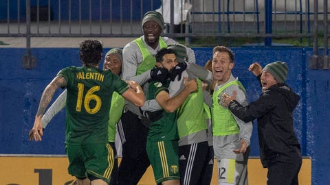 Oct 31, 2018; Frisco, TX, USA; Portland Timbers midfielder Diego Valeri (8) celebrates a goal with his teammates in the second half agains FC Dallas at Toyota Stadium. Mandatory Credit: Tim Heitman-USA TODAY Sports