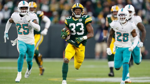 <p>               Green Bay Packers' Aaron Jones breaks away for a 67-yard run during the first half of an NFL football game against the Miami Dolphins Sunday, Nov. 11, 2018, in Green Bay, Wis. (AP Photo/Matt Ludtke)             </p>