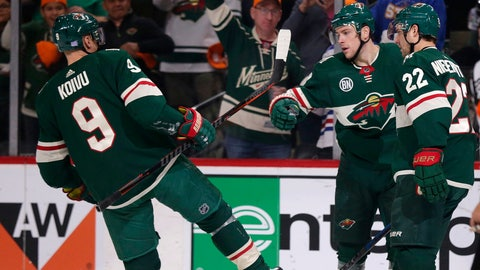 <p>               Minnesota Wild center Charlie Coyle (3) celebrates his goal with Mikko Koivu (9) and Nino Niederreiter (22) during the first period of an NHL hockey game against the Vancouver Canucks on Thursday, Nov. 15, 2018, in St. Paul, Minn. (AP Photo/Andy Clayton-King)             </p>