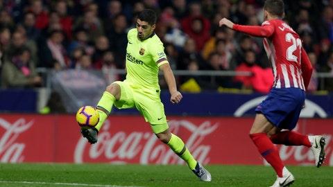 <p>               Barcelona's Luis Suarez, left kicks the ball during a Spanish La Liga soccer match between Atletico Madrid and FC Barcelona at the Metropolitano stadium in Madrid, Saturday, Nov. 24, 2018. (AP Photo/Manu Fernandez)             </p>