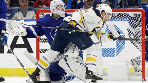 <p>               Buffalo Sabres right wing Kyle Okposo (21) runs into Tampa Bay Lightning goaltender Louis Domingue (70) after the puck hit the post during the second period of an NHL hockey game Thursday, Nov. 29, 2018, in Tampa, Fla. (AP Photo/Chris O'Meara)             </p>