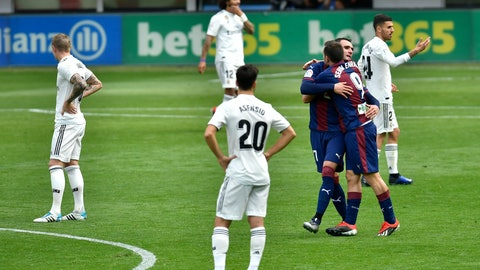 <p>               Deportivo SD Eibar's Sergi Enrich, second right, celebrates after scoring his team's second goal of the game during the Spanish La Liga soccer match between Real Madrid and SD Eibar at Ipurua stadium, in Eibar, northern Spain, Saturday, Nov. 24, 2018. (AP Photo/Alvaro Barrientos)             </p>