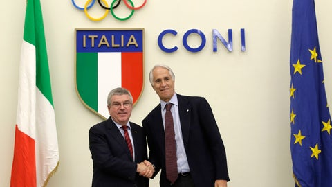 <p>               International Olympic Committee President Thomas Bach, left, and Italian Olympic Committee President Giovanni Malago', shakes hands for photographers at the end of a press conference in Rome, Thursday, Nov. 8, 2018. Bach has given his blessing for Milan and Cortina d'Ampezzo's bid for the 2026 Winter Olympics to move forward without funding from the Italian government.  (AP Photo/Alessandra Tarantino)             </p>