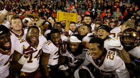 <p>               Minnesota players celebrate with the Paul Bunyan Axe trophy after beating Wisconsin 37-15 in an NCAA college football game Saturday, Nov. 24, 2018, in Madison, Wis. (AP Photo/Andy Manis)             </p>