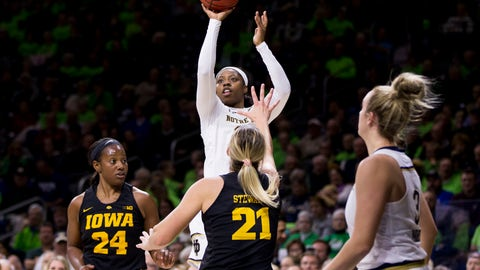 <p>               Notre Dame's Arike Ogunbowale shoots a three-point basket over Iowa's Zion Sanders (24) and Hannah Stewart (21) during the first half of an NCAA college basketball game Thursday, Nov. 29, 2018, in South Bend, Ind. (AP Photo/Robert Franklin)             </p>
