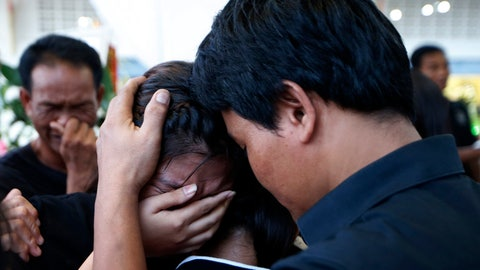 <p>               In this Thursday, Nov. 15, 2018, photo, relatives of 13-year-old Thai kickboxer Anucha Tasako cry during his funeral services at a Buddhist temple in Samut Prakan province, Thailand. Anucha died of a brain hemorrhage two days after he was knocked out in a bout on Nov. 10 that was his 174th match in the career he started at age 8. Thai lawmakers recently suggested barring children younger than 12 from competitive boxing, but boxing enthusiasts strongly oppose the change. (AP Photo/Sakchai Lalit)             </p>