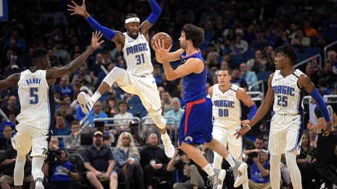 <p>               Los Angeles Clippers guard Milos Teodosic, center, passes the ball in front of Orlando Magic center Mohamed Bamba (5), guard Terrence Ross (31), forward Aaron Gordon (00) and forward Wesley Iwundu (25) during the first half of an NBA basketball game Friday, Nov. 2, 2018, in Orlando, Fla. (AP Photo/Phelan M. Ebenhack)             </p>