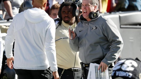 <p>               Colorado head coach Mike MacIntyre, right, confers with sideline personnel in the first half of an NCAA college football game against Washington State Saturday, Nov. 10, 2018, in Boulder, Colo. (AP Photo/David Zalubowski)             </p>