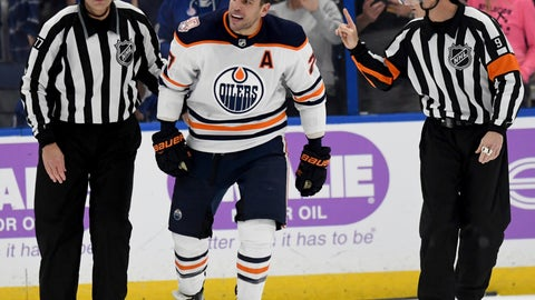 <p>               Linesman Tim Nowak (77) skates Edmonton Oilers left wing Milan Lucic (27) toward the penalty box during the third period of the team's NHL hockey game against the Tampa Bay Lightning on Tuesday, Nov. 6, 2018, in Tampa, Fla. (AP Photo/Jason Behnken)             </p>