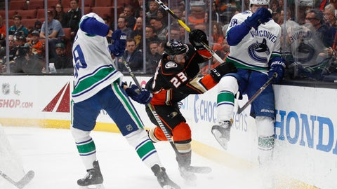 <p>               Anaheim Ducks' Brian Gibbons, center, fights for the puck with Vancouver Canucks' Darren Archibald, left, and Adam Gaudette during the first period of an NHL hockey game Wednesday, Nov. 21, 2018, in Anaheim, Calif. (AP Photo/Jae C. Hong)             </p>