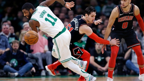<p>               Boston Celtics guard Kyrie Irving (11) fakes out Chicago Bulls guard Ryan Arcidiacono (51) as he dribbles behind his back on a drive to the basket during the first quarter of an NBA basketball game in Boston, Wednesday, Nov. 14, 2018. (AP Photo/Charles Krupa)             </p>
