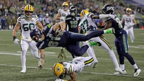 <p>               Seattle Seahawks tight end Nick Vannett (81) gets horizontal above Green Bay Packers cornerback Tramon Williams, lower-center, as Vannett carries the ball just short of the goal line against the Green Bay Packers during the first half of an NFL football game, Thursday, Nov. 15, 2018, in Seattle. (AP Photo/Stephen Brashear)             </p>