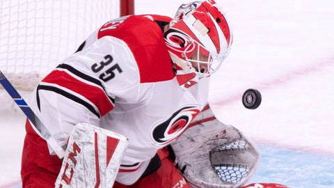 <p>               Carolina Hurricanes goaltender Curtis McElhinney makes a save against the Montreal Canadiens during the first period of an NHL hockey game Tuesday, Nov. 27, 2018, in Montreal. (Paul Chiasson/The Canadian Press via AP)             </p>