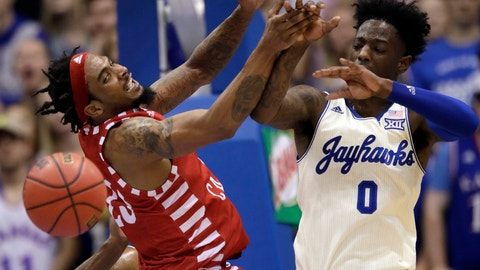 <p>               Louisiana Lafayette forward JaKeenan Gant, left, tries to rebound against Kansas guard Marcus Garrett (0) during the first half of an NCAA college basketball game in Lawrence, Kan., Friday, Nov. 16, 2018. (AP Photo/Orlin Wagner)             </p>