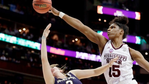 """<p>               FILE - In this April 1, 2018, file photo, Mississippi State's Teaira McCowan (15) blocks a shot by Notre Dame's Marina Mabrey (3) during the first half in the final of the women's NCAA Final Four college basketball tournament in Columbus, Ohio. Mississippi State coach Vic Schaefer is fond of calling McCowan his """"Aircraft Carrier."""" She's 6-foot-7 with a huge wingspan and among just a handful of true post players who can give programs a sizable advantage. (AP Photo/Tony Dejak, File)             </p>"""