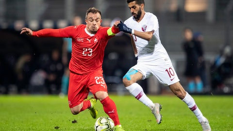 <p>               Switzerland's Xherdan Shaqiri, left, fights for the ball with Qatar's Hassan Khalid Al Haidos during an international friendly soccer match between Switzerland and Qatar at the Cornaredo stadium in Lugano, Switzerland, Wednesday, Nov. 14, 2018. (Ennio Leanza/Keystone via AP)             </p>