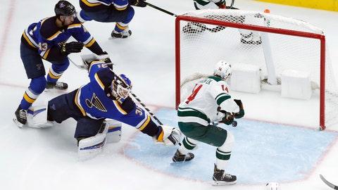 <p>               Minnesota Wild's Joel Eriksson Ek (14), of Sweden, scores past St. Louis Blues goaltender Chad Johnson and Jordan Schmaltz (43) during the second period of an NHL hockey game Sunday, Nov. 11, 2018, in St. Louis. (AP Photo/Jeff Roberson)             </p>
