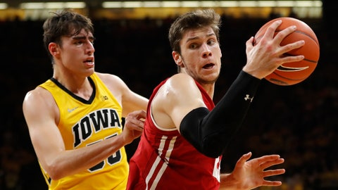 <p>               Wisconsin forward Ethan Happ drives past Iowa forward Luka Garza, left, during the first half of an NCAA college basketball game Friday, Nov. 30, 2018, in Iowa City, Iowa.(AP Photo/Charlie Neibergall)             </p>