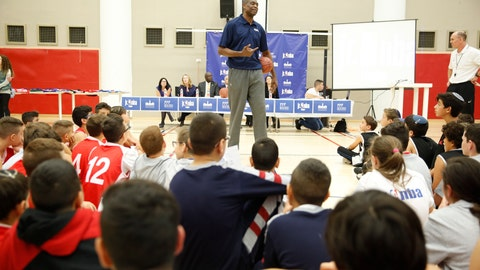 <p>               NBA Hall of Famer Dikembe Mutombo talks to kids during a workshop at the Sylvan Adams sports center at the YMCA In Jerusalem, Tuesday, November 27, 2018. (AP Photo/Ariel Schalit)             </p>