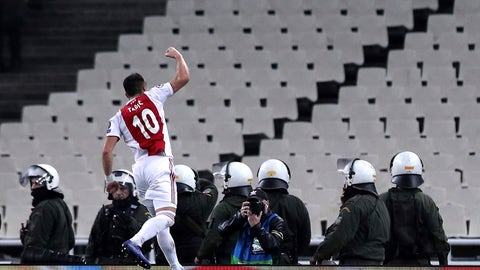 <p>               Ajax's Dusan Tadic celebrates his goal gainst AEK during a Group E Champions League soccer match between AEK Athens and Ajax at the Olympic Stadium in Athens, Tuesday, Nov. 27, 2018. (AP Photo/Petros Giannakouris)             </p>