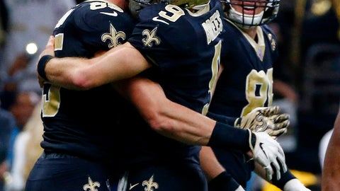 <p>               New Orleans Saints quarterback Drew Brees (9) hugs tight end Dan Arnold (85) after the two connected on a touchdown reception in the second half of an NFL football game against the Atlanta Falcons in New Orleans, Thursday, Nov. 22, 2018. (AP Photo/Butch Dill)             </p>