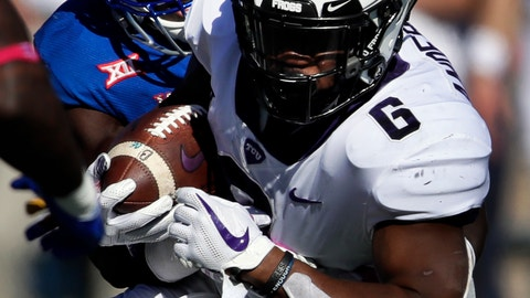 <p>               TCU running back Darius Anderson (6) his tackled by Kansas defensive end Azur Kamara, left, during the first half of an NCAA college football game in Lawrence, Kan., Saturday, Oct. 27, 2018. (AP Photo/Orlin Wagner)             </p>