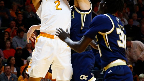 <p>               Tennessee forward Grant Williams (2) shoots as he's fouled by Georgia Tech forward Evan Cole (3) during the first half of an NCAA college basketball game Tuesday, Nov. 13, 2018, in Knoxville, Tenn. (AP photo/Wade Payne)             </p>