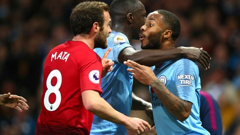 <p>               Manchester City's Benjamin Mendy, centre, holding Manchester City's Rahhem Sterling as he argues with Manchester United's Juan Mata during the English Premier League soccer match between Manchester City and Manchester United at the Etihad stadium in Manchester, England, Sunday, Nov. 11, 2018. (AP Photo/Dave Thompson)             </p>