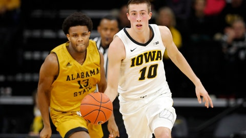 <p>               Iowa guard Joe Wieskamp (10) brings the ball up ahead of Alabama State guard AJ Farrar, left, during the first half of an NCAA college basketball game Wednesday, Nov. 21, 2018, in Iowa City, Iowa.(AP Photo/Charlie Neibergall)             </p>