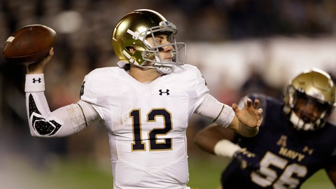 <p>               File-This Oct. 27, 2018, file photo shows Notre Dame quarterback Ian Book (12) preparing to throw a pass during the second half of an NCAA college football game in San Diego. Notre Dame has persevered through its regular season without a defeat, and the path before the Fighting Irish is suddenly clear. With a win over Southern California, Notre Dame will secure a spot in the College Football Playoff. (AP Photo/Gregory Bull, File)             </p>