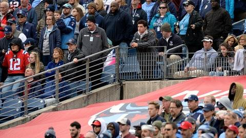 <p>               A hole is left in the tarp that covers the Tennessee Titans player entrance to the field as fans watch the Titans play the New England Patriots in the second half of an NFL football game in Nissan Stadium, Sunday, Nov. 11, 2018, in Nashville, Tenn. Officials say a fan, Thomas Carrico Jr., 37, of Goodlettesville, Tenn., fell from the seats and through the tarp to the concrete floor when cheerleaders were tossing out shirts to the crowd. Carrico was taken to Vanderbilt University Medical Center. (AP Photo/Mark Zaleski)             </p>