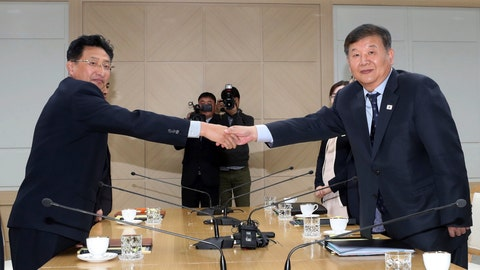 <p>               Roh Tae-kang, right, South Korea's vice minister of culture and sports, shakes hands with his North Korean counterpart Won Kil U while posing for a photo during a meeting at the inter-Korean liaison office in Kaesong, North Korea, Friday, Nov. 2, 2018. North and South Korea agreed to officially inform the International Olympic Committee of their intent to co-host the 2032 Summer Olympics. (Korea Pool/Yonhap via AP)             </p>