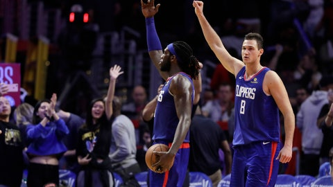 <p>               Los Angeles Clippers' Montrezl Harrell, center, and Danilo Gallinari, celebrate after a 112-107 overtime win over the Memphis Grizzlies during an NBA basketball game Friday, Nov. 23, 2018, in Los Angeles. (AP Photo/Marcio Jose Sanchez)             </p>