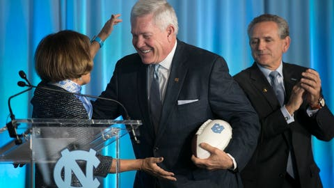 <p>               Mack Brown, center, is introduced by University of North Carolina Chancellor Carol Folt, left, as the school's new NCAA college football coach during a news conference, Tuesday, Nov. 27, 2018, at Kenan Stadium in Chapel Hill, N.C. Brown spent 10 seasons at UNC from 1988-97 before leaving for Texas. He left there in 2013 and has been in broadcasting in the years since. (Robert Willett/The News & Observer via AP)             </p>