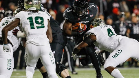 <p>               Cincinnati running back Michael Warren II (3) runs the ball against South Florida linebacker Greg Reaves (4) during the first half of an NCAA college football game, Saturday, Nov. 10, 2018, in Cincinnati. (AP Photo/John Minchillo)             </p>