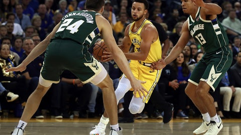 <p>               Golden State Warriors' Stephen Curry, center, drives the ball between Milwaukee Bucks' Pat Connaughton (24) and Malcolm Brogdon, right, during the first half of an NBA basketball game Thursday, Nov. 8, 2018, in Oakland, Calif. (AP Photo/Ben Margot)             </p>