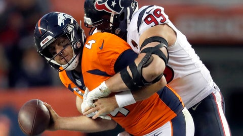 <p>               Denver Broncos quarterback Case Keenum (4) manages to get the pass away as Houston Texans defensive end J.J. Watt (99) makes the hit during the second half of an NFL football game, Sunday, Nov. 4, 2018, in Denver. The Texans won 19-17. (AP Photo/David Zalubowski)             </p>