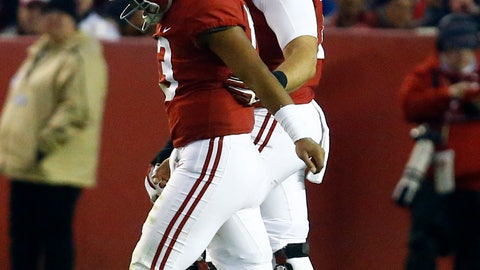 <p>               Alabama quarterback Tua Tagovailoa (13) is helped off the field by offensive lineman Jedrick Wills Jr. (74) during the second half of an NCAA college football game against Mississippi State, Saturday, Nov. 10, 2018, in Tuscaloosa, Ala.  (AP Photo/Butch Dill)             </p>