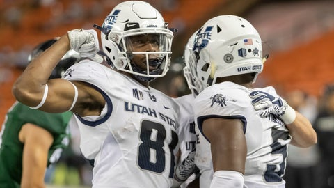 <p>               Utah State wide receiver Savon Scarver (81) celebrates a touchdown run by his teammate running back Darwin Thompson (5) in the second half of an NCAA college football game against Hawaii, Saturday, Nov. 3, 2018, in Honolulu. (AP Photo/Eugene Tanner)             </p>