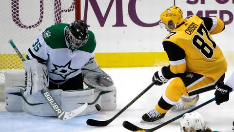 <p>               Pittsburgh Penguins' Sidney Crosby (87) collects a rebound off Dallas Stars goaltender Anton Khudobin (35) and scores during the first period of an NHL hockey game in Pittsburgh, Wednesday, Nov. 21, 2018. (AP Photo/Gene J. Puskar)             </p>