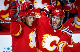 Flames rally in 3rd again, beat Blackhawks 5-3