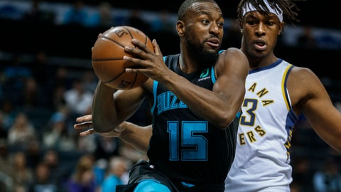 <p>               Charlotte Hornets guard Kemba Walker, left, looks to pass the ball as Indiana Pacers center Myles Turner defends during the first half of an NBA basketball game in Charlotte, N.C., Wednesday, Nov. 21, 2018. (AP Photo/Nell Redmond)             </p>
